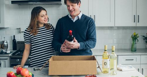 Photo of couple opening box of wine from Firstleaf